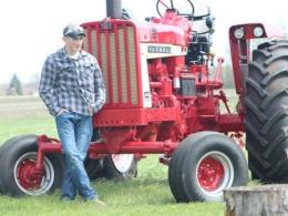 Young man and tractor